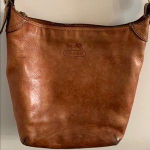 Brown crossbody Coach purse